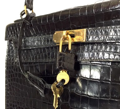 View 16. Thumbnail of Lot 743. HERMÈS | BLACK KELLY 28 IN SHINY CROCODILE WITH GOLD HARDWARE, 1962.