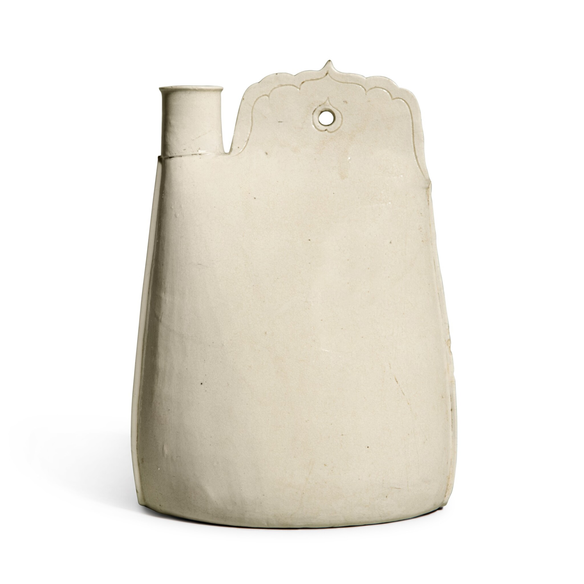 View full screen - View 1 of Lot 187. A rare white-glazed flask, Liao dynasty | 遼 白釉皮囊壺.