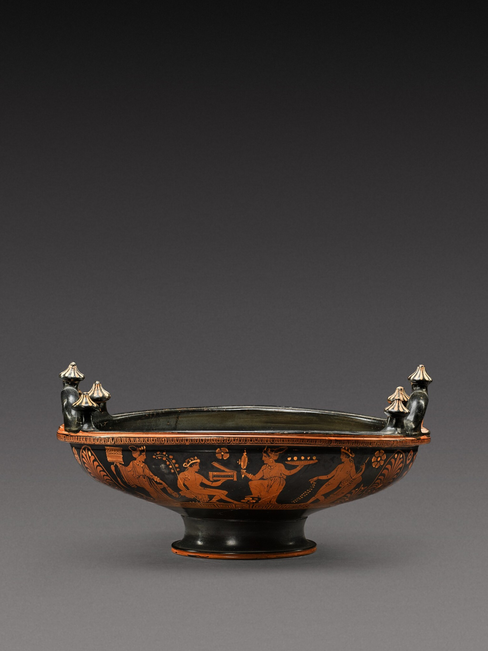 View full screen - View 1 of Lot 20. An Apulian Red-figured Patera, attributed to the Iliupersis Painter, circa 350-330 B.C..