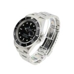 ROLEX | REFERENCE 16610 SUBMARINER  A STAINLESS STEEL AUTOMATIC WRISTWATCH WITH DATE AND BRACELET, CIRCA 2005