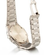 PATEK PHILIPPE | NAUTILUS, REFERENCE 7010, A WHITE GOLD AND DIAMOND-SET BRACELET WATCH WITH DATE, CIRCA 2008