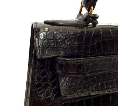 View 10. Thumbnail of Lot 743. HERMÈS | BLACK KELLY 28 IN SHINY CROCODILE WITH GOLD HARDWARE, 1962.