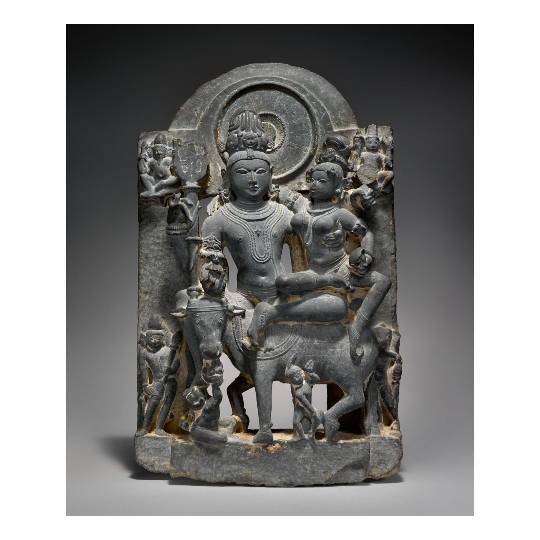View full screen - View 1 of Lot 353.  A BLACK STONE FIGURE OF UMA-MAHESHVARA,  WESTERN INDIA, HARYANA, 12TH CENTURY.