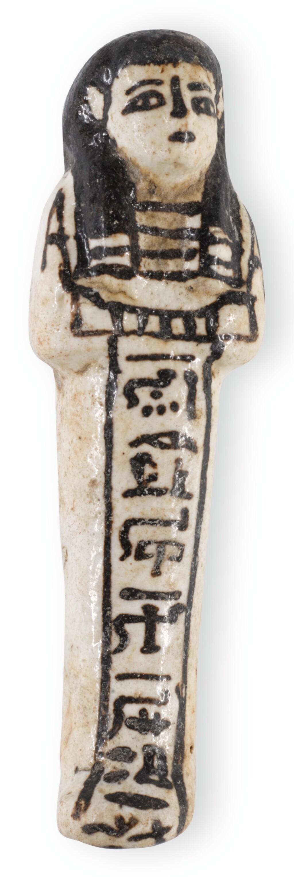 AN EGYPTIAN GLAZED FAIENCE USHABTI, 19TH/20TH DYNASTY, CIRCA 1292-1075 B.C.