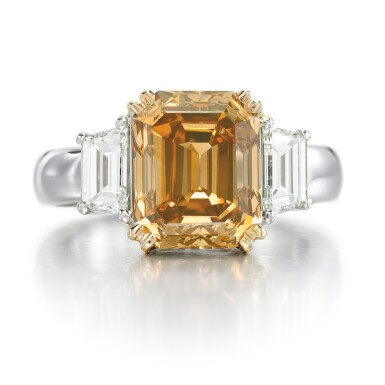 View 1. Thumbnail of Lot 10. FANCY BROWN-ORANGE DIAMOND AND DIAMOND RING.