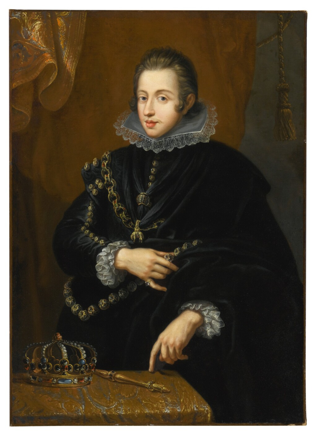 FLEMISH SCHOOL, 17TH CENTURY   PORTRAIT OF KING PHILIP IV OF SPAIN, HALF LENGTH, DRESSED IN BLACK ROBES WITH A GOLILLA COLLAR AND STANDING BEFORE A TABLE WITH A CROWN AND SCEPTRE