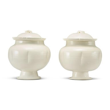 View 3. Thumbnail of Lot 184. A pair of white-glazed footed jars and covers, Northern Song / Jin dynasty | 北宋 / 金 白釉瓜棱式高足蓋罐一對.
