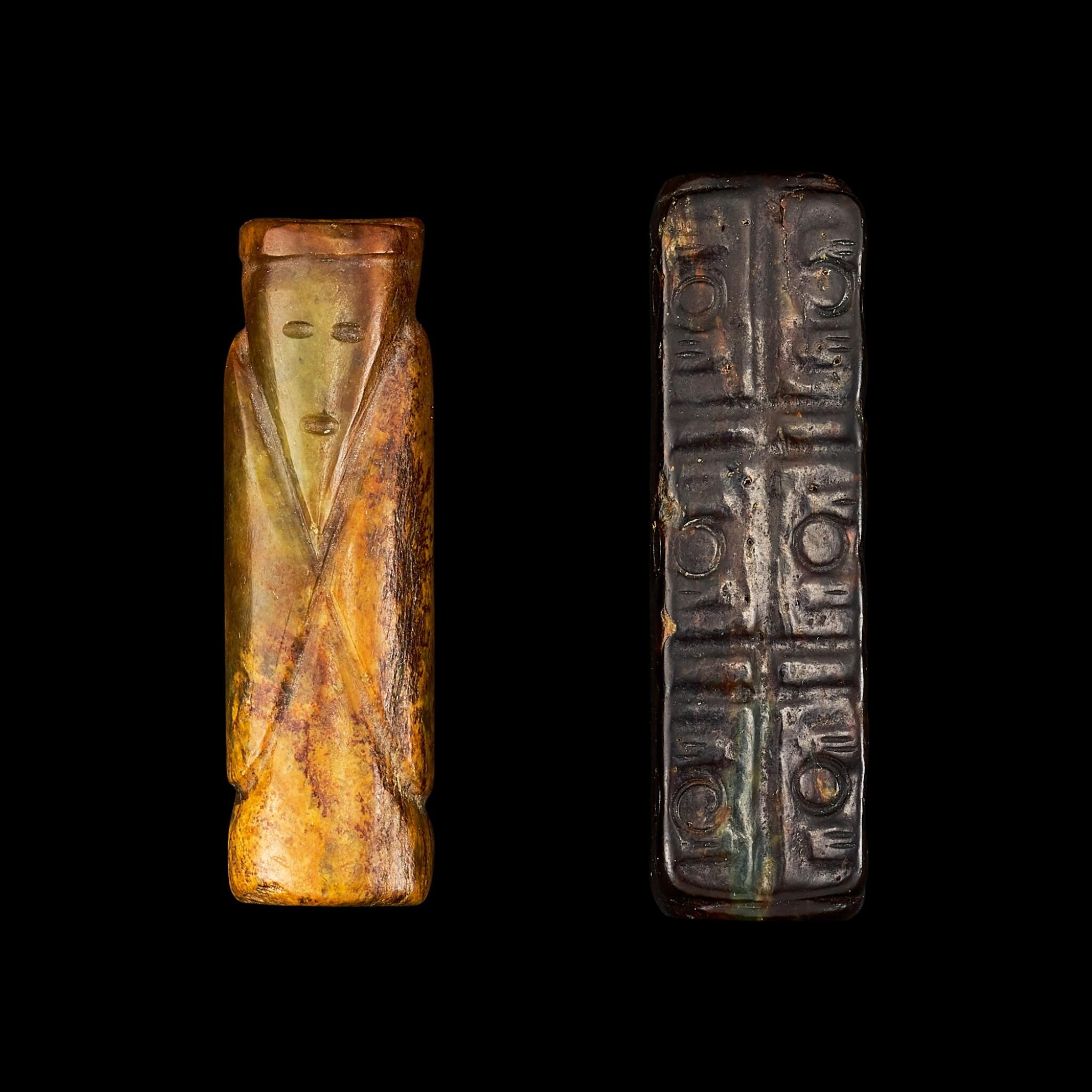 View full screen - View 1 of Lot 135. A celadon jade 'figure' bead and a black jade cong Qing dynasty   清 墨玉琮式及青玉翁仲形管珠一組兩件.