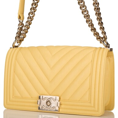 View 4. Thumbnail of Lot 98. CHANEL |  YELLOW CHEVRON OLD MEDIUM BOY BAG OF CAVIAR LEATHER WITH LIGHT GOLD TONE HARDWARE.