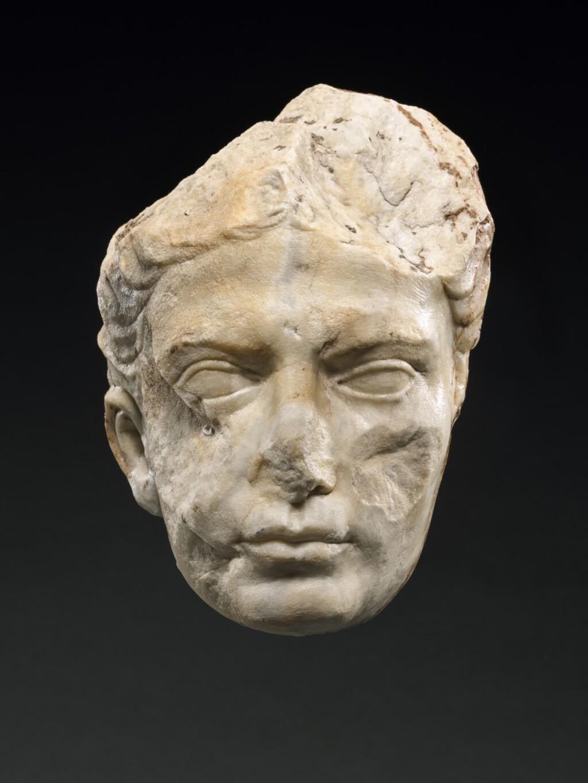 A FRAGMENTARY ROMAN MARBLE PORTRAIT HEAD OF A WOMAN, LATE AUGUSTAN/TIBERIAN, CIRCA A.D. 1-37