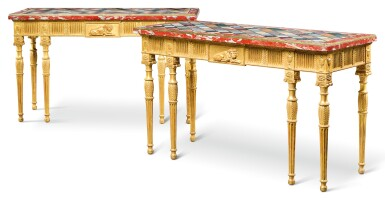 A PAIR OF GEORGE III STYLE SPECIMEN MARBLE TOPPED CARVED GILTWOOD TABLES AFTER A MODEL BY MAYHEW AND INCE