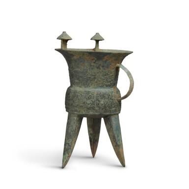View 2. Thumbnail of Lot 4. An archaic bronze ritual wine vessel (Jia), Middle Shang dynasty   商中期 青銅饕餮紋斝.