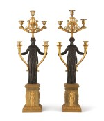 A PAIR OF EMPIRE STYLE GILT AND PATINATED BRONZE SIX-LIGHT CANDELABRA
