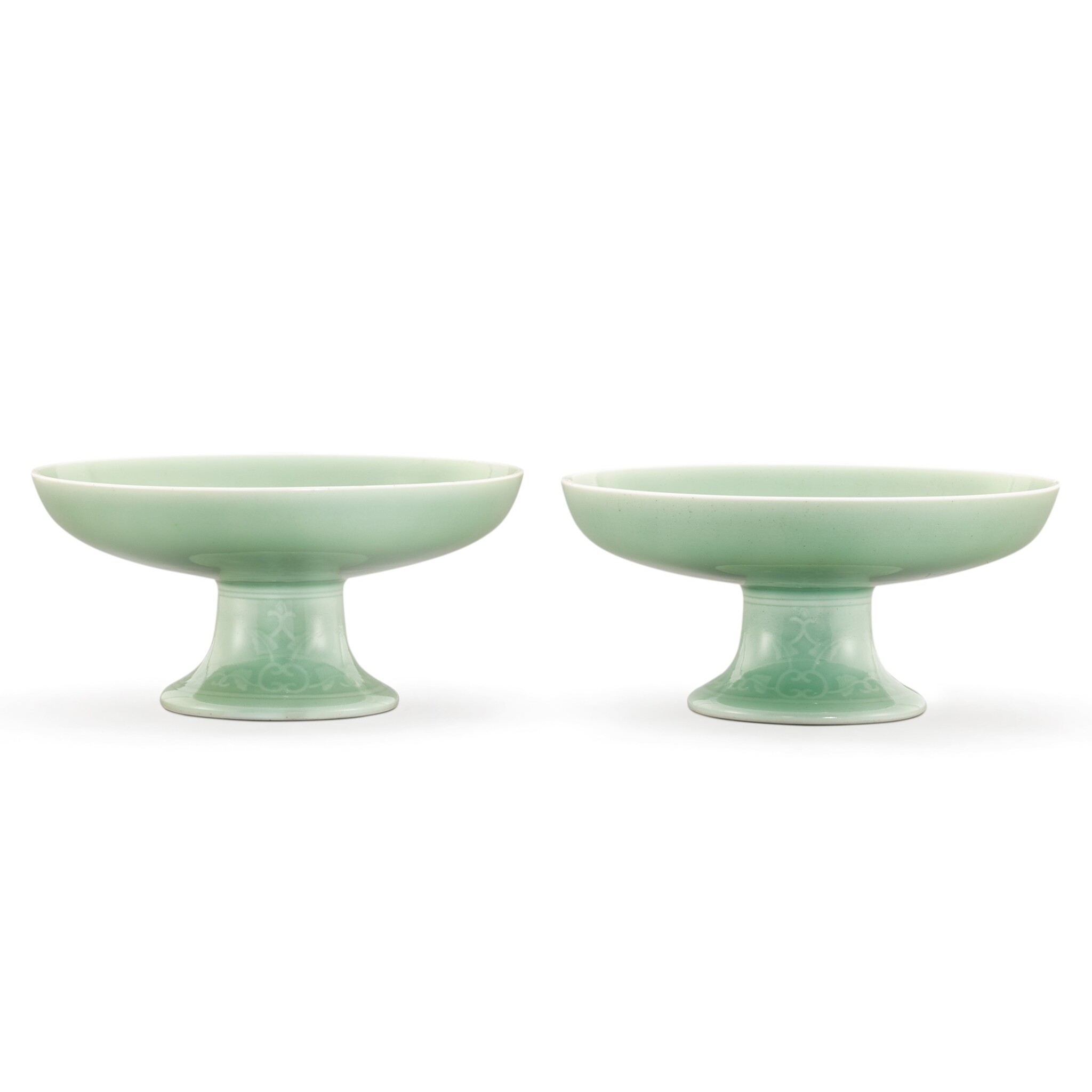 View 1 of Lot 111. A PAIR OF CELADON-GLAZED TAZZA DISHES SEAL MARKS AND PERIOD OF QIANLONG | 清乾隆 粉青釉花卉紋供盤一對 《大清乾隆年製》款.