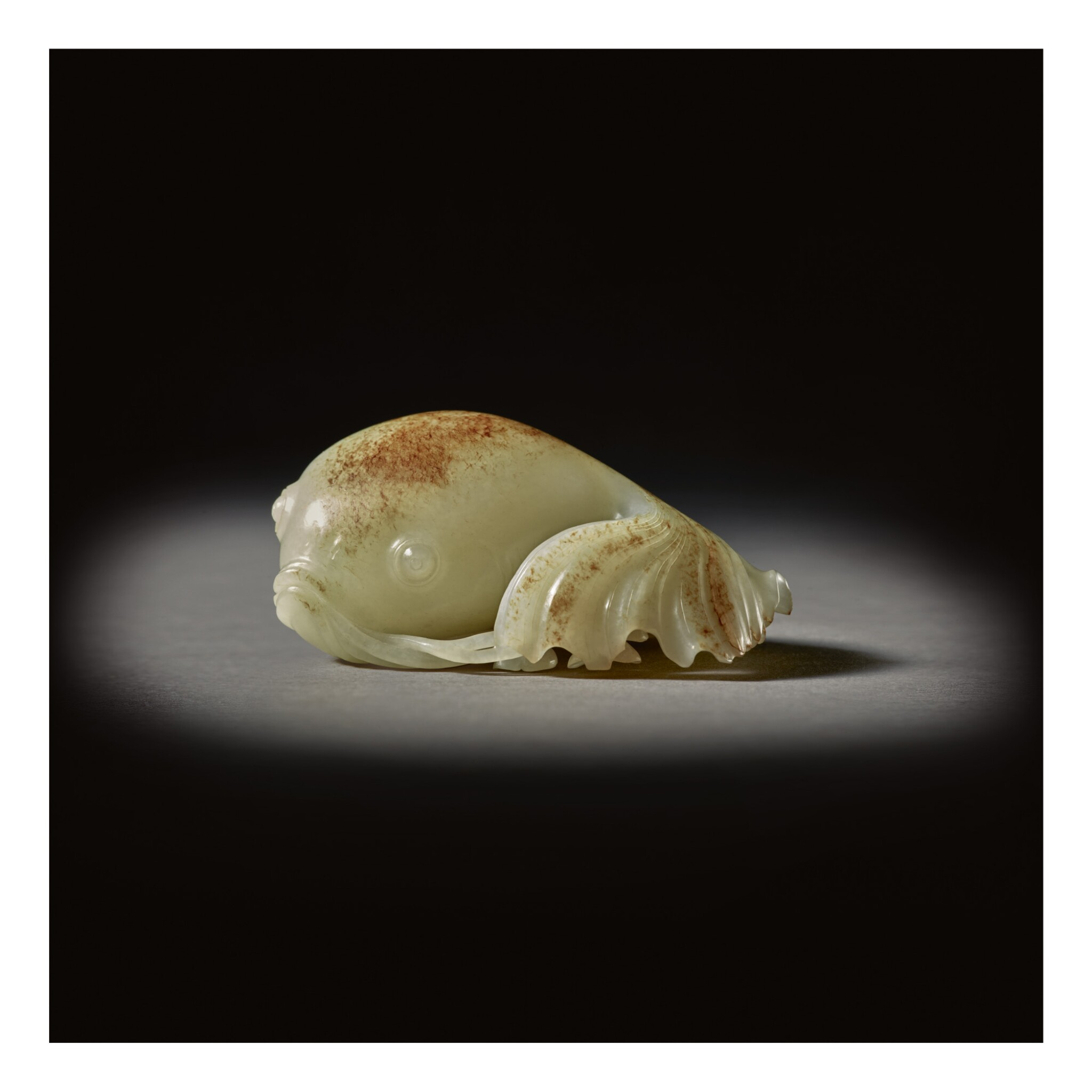 View full screen - View 1 of Lot 206.  A SUPERB WHITE AND RUSSET JADE CARVING OF A GOLDFISH,  QING DYNASTY, QIANLONG PERIOD.