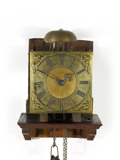 View 2. Thumbnail of Lot 60. Thomas Tompion: A small walnut 30-hour wall clock, London, circa 1700.