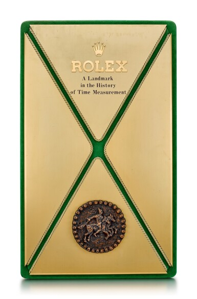 View 1. Thumbnail of Lot 8092. ROLEX   A GILT BRASS AND LEATHER DISPLAY, CIRCA 1970.