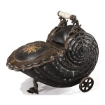 A BLACK AND GOLD PAINTED TOLE SHELL-FORM PURDONIUM ON WHEELS
