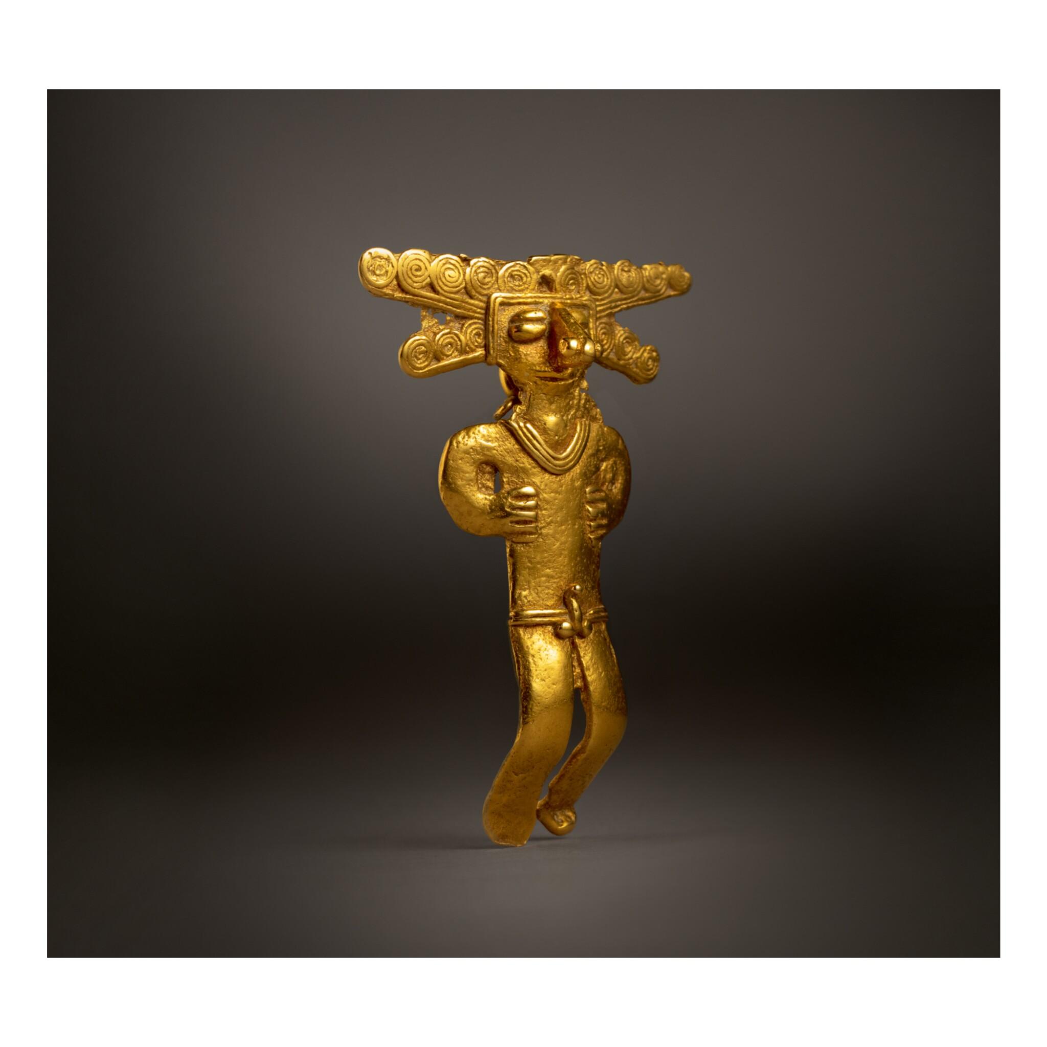 COLOMBIAN GOLD FIGURAL PENDANT, TOLIMA OR QUIMBAYA REGION CIRCA AD 500-1000