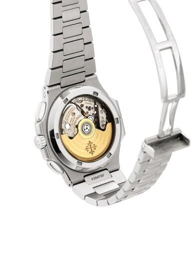 View 3. Thumbnail of Lot 2066. Patek Philippe | Nautilus, Reference 5990, A stainless steel dual time zone flyback chronograph bracelet watch with date, Circa 2014 | 百達翡麗 | Nautilus 型號5990   精鋼兩地時間飛返計時鏈帶腕錶,備日期顯示,約2014年製.