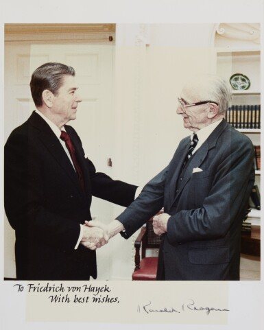 View 1. Thumbnail of Lot 19. RONALD REAGAN, SIGNED PHOTOGRAPH OF THE PRESIDENT AND HAYEK, [1983].