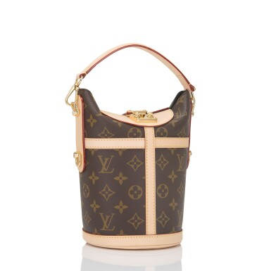 View 2. Thumbnail of Lot 55. Louis Vuitton Monogram Duffle Bag PM of Coated Canvas and Gold Tone Hardware.