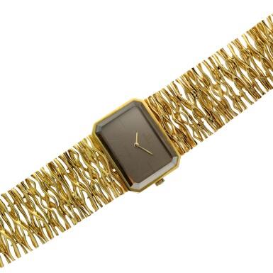 View 6. Thumbnail of Lot 65. Reference 8272 De Ville Designed by Gilbert Albert: A yellow gold rectangular bracelet watch, Circa 1965.