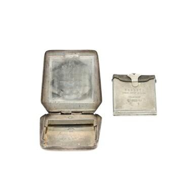 View 5. Thumbnail of Lot 100. A silver purse shaped travel clock, Circa 1930.