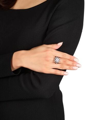 View 2. Thumbnail of Lot 1656. Sotheby's Diamonds by Joseph Ramsay   'Skeleton Saxony' Diamond, Sapphire and Grossular Garnet Ring   「蘇富比鑽石」Joseph Ramsay設計  「薩克森」5.20克拉 圓形 D色 內部無瑕 鑽石 配 藍寶石 及 石榴石 戒指.
