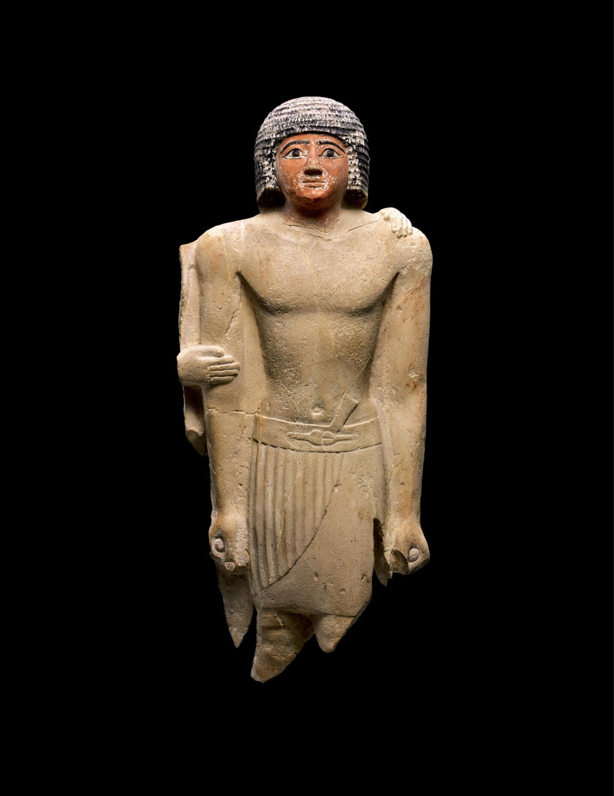 View full screen - View 1 of Lot 267. AN EGYPTIAN LIMESTONE FIGURE OF A MAN,  5TH DYNASTY, 2520-2360 B.C..