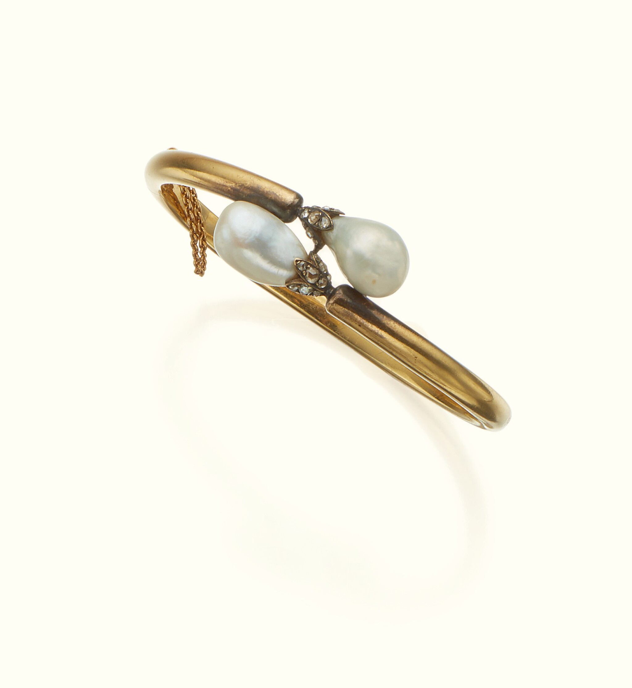 View full screen - View 1 of Lot 46. A GOLD, PEARL, AND DIAMOND BANGLE.