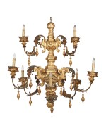 AN ITALIAN BAROQUE STYLE CARVED AND GILTWOOD AND TÔLE NINE-LIGHT CHANDELIER