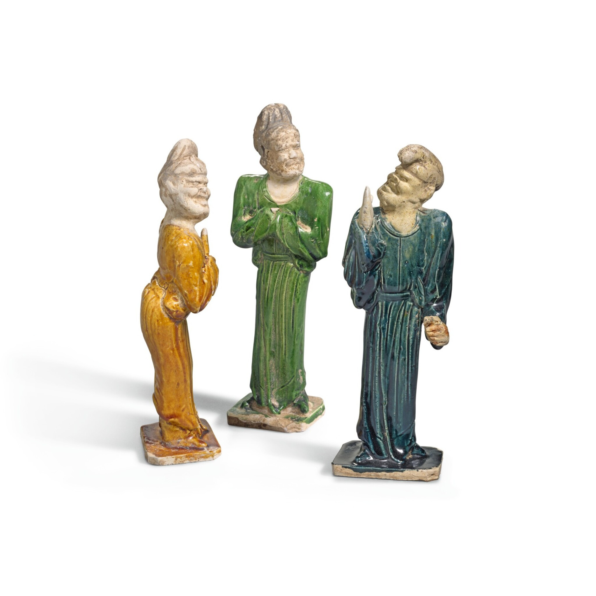 View full screen - View 1 of Lot 223. THREE POTTERY FIGURES OF FOREIGNERS, TANG DYNASTY | 唐 胡人陶俑一組三件.