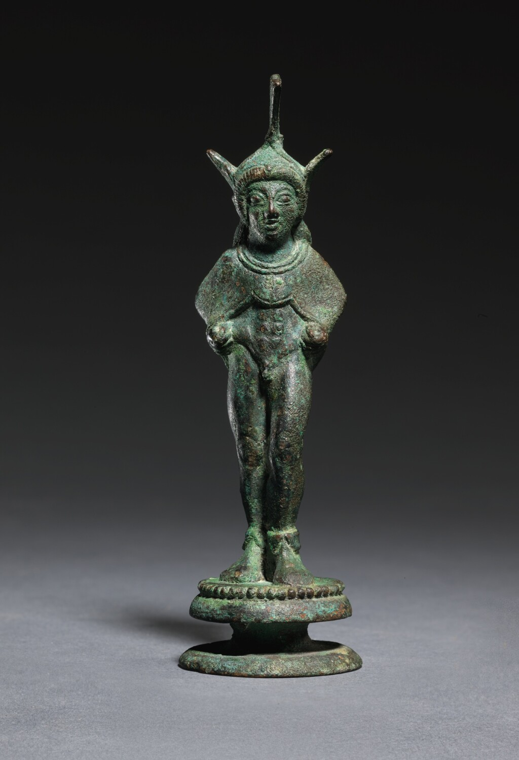 AN ETRUSCAN BRONZE FIGURE OF A WARRIOR, CIRCA 500-475 B.C.