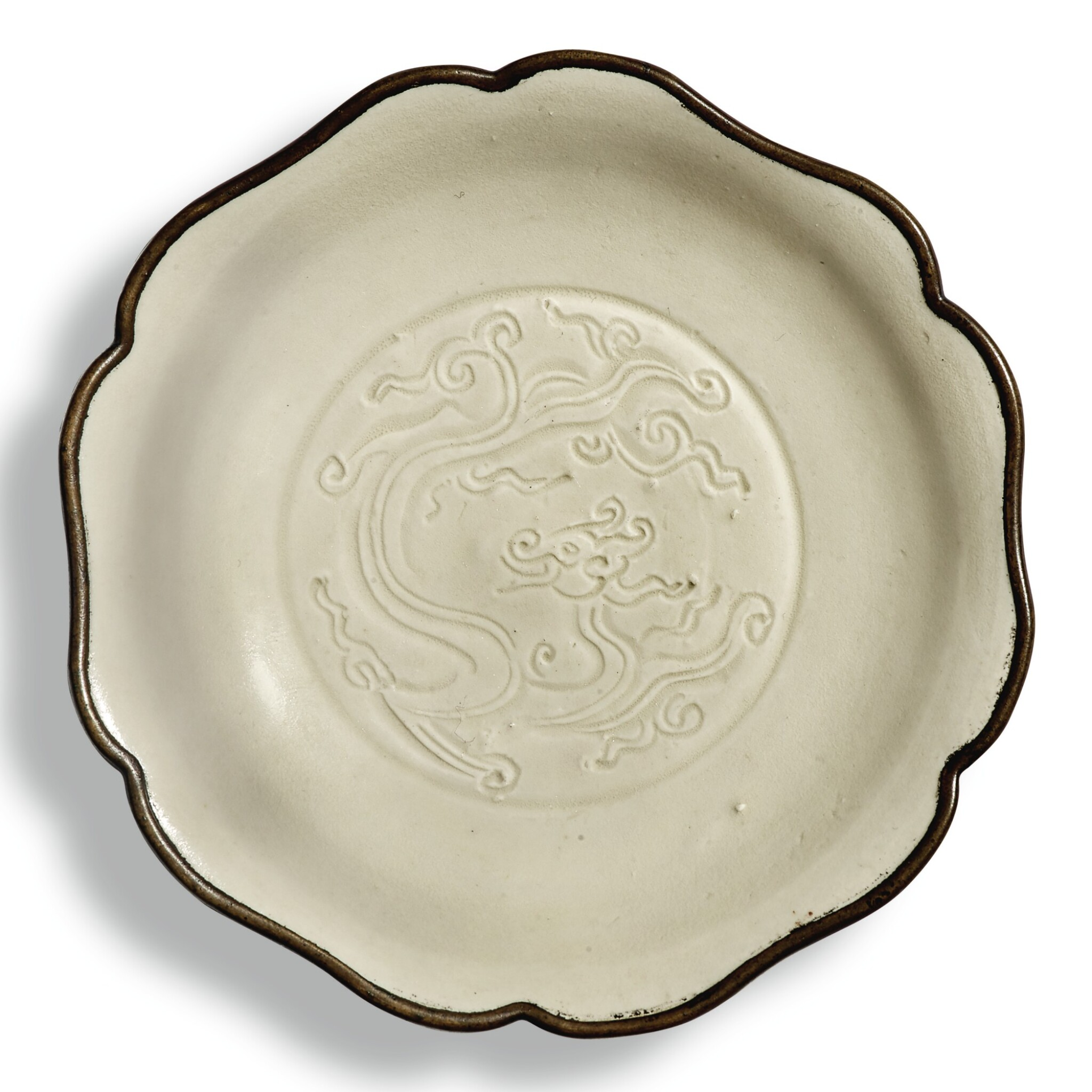 View full screen - View 1 of Lot 140. A carved 'Ding' 'dragon' dish, Northern Song dynasty   北宋 定窰白釉刻龍紋葵口盤.