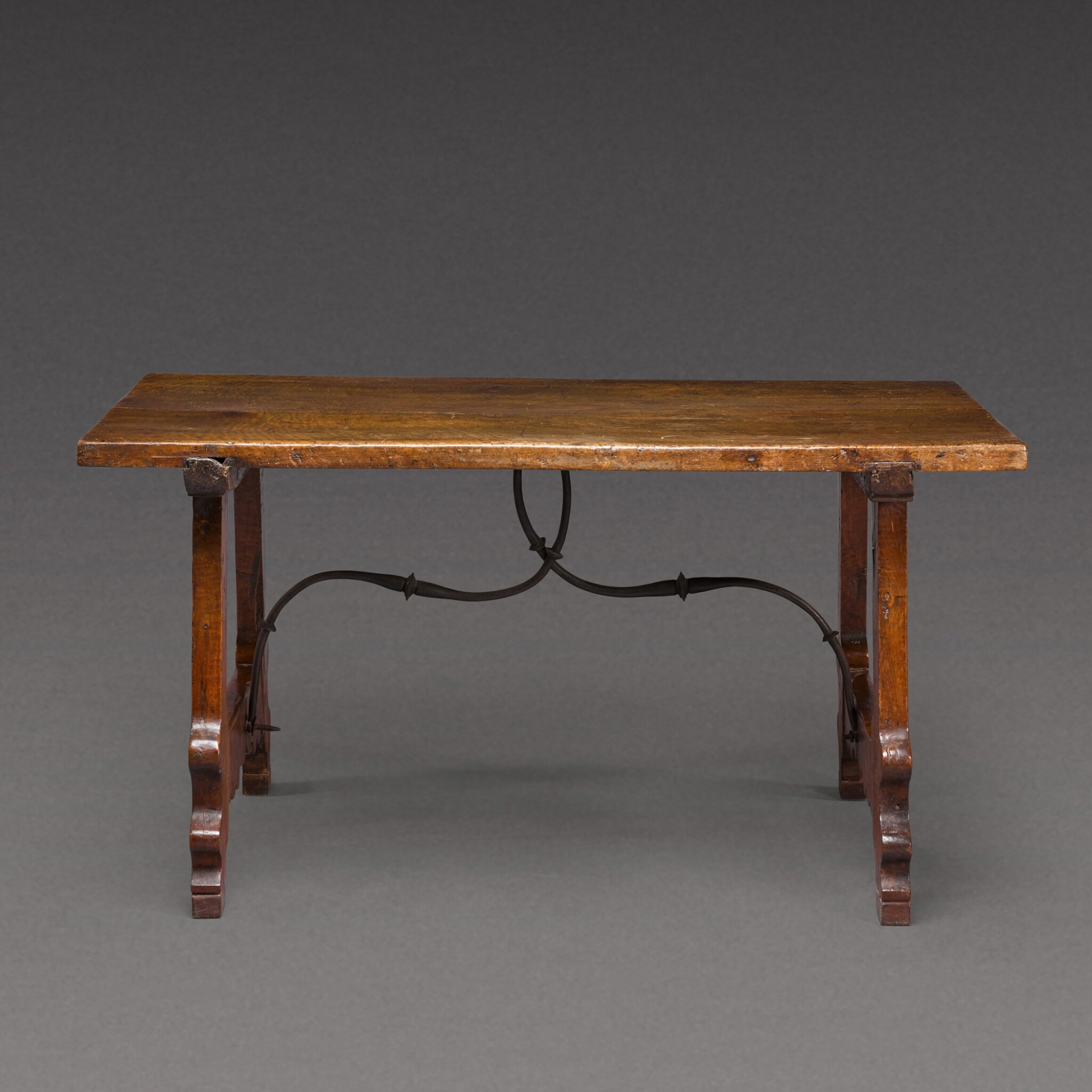 View 1 of Lot 176. A Spanish Baroque walnut trestle table, 17th century.