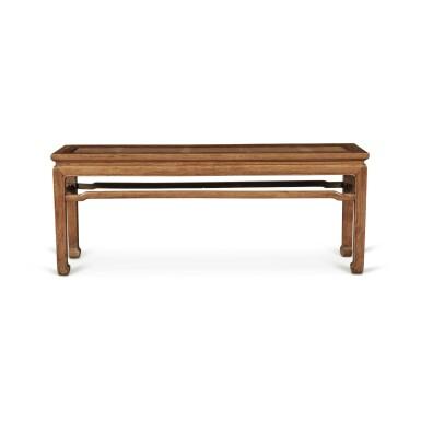 View 1. Thumbnail of Lot 113. A 'huanghuali' corner-leg bench (Errendeng), Qing dynasty, 18th century   清十八世紀 黃花梨有束腰羅鍋棖馬蹄足貳人凳.