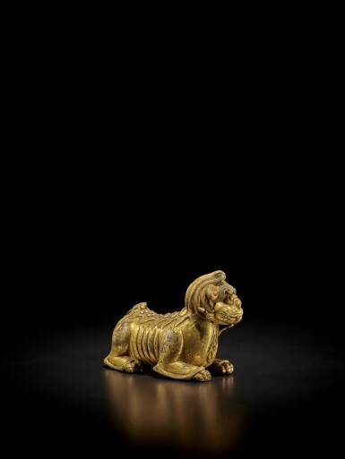 View 3. Thumbnail of Lot 125. A gilt-bronze 'mythical beast' weight, Ming dynasty | 明 銅鎏金瑞獸形鎮.