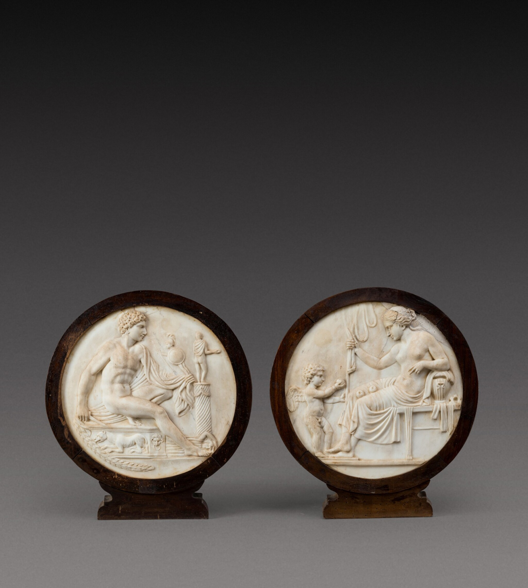 View full screen - View 1 of Lot 114. Italian, 19th century | Pair of Relief Medallions with Venus and Cupid and Mars.