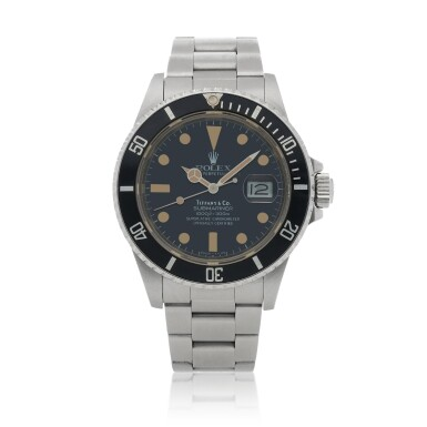 View 1. Thumbnail of Lot 518. Retailed by Tiffany & Co.: Submariner, Ref. 16800 Stainless steel wristwatch with date and bracelet Circa 1985   勞力士 零售商為蒂芙尼:16800型號「Submariner」精鋼鍊帶腕錶備日期顯示,年份約1985.