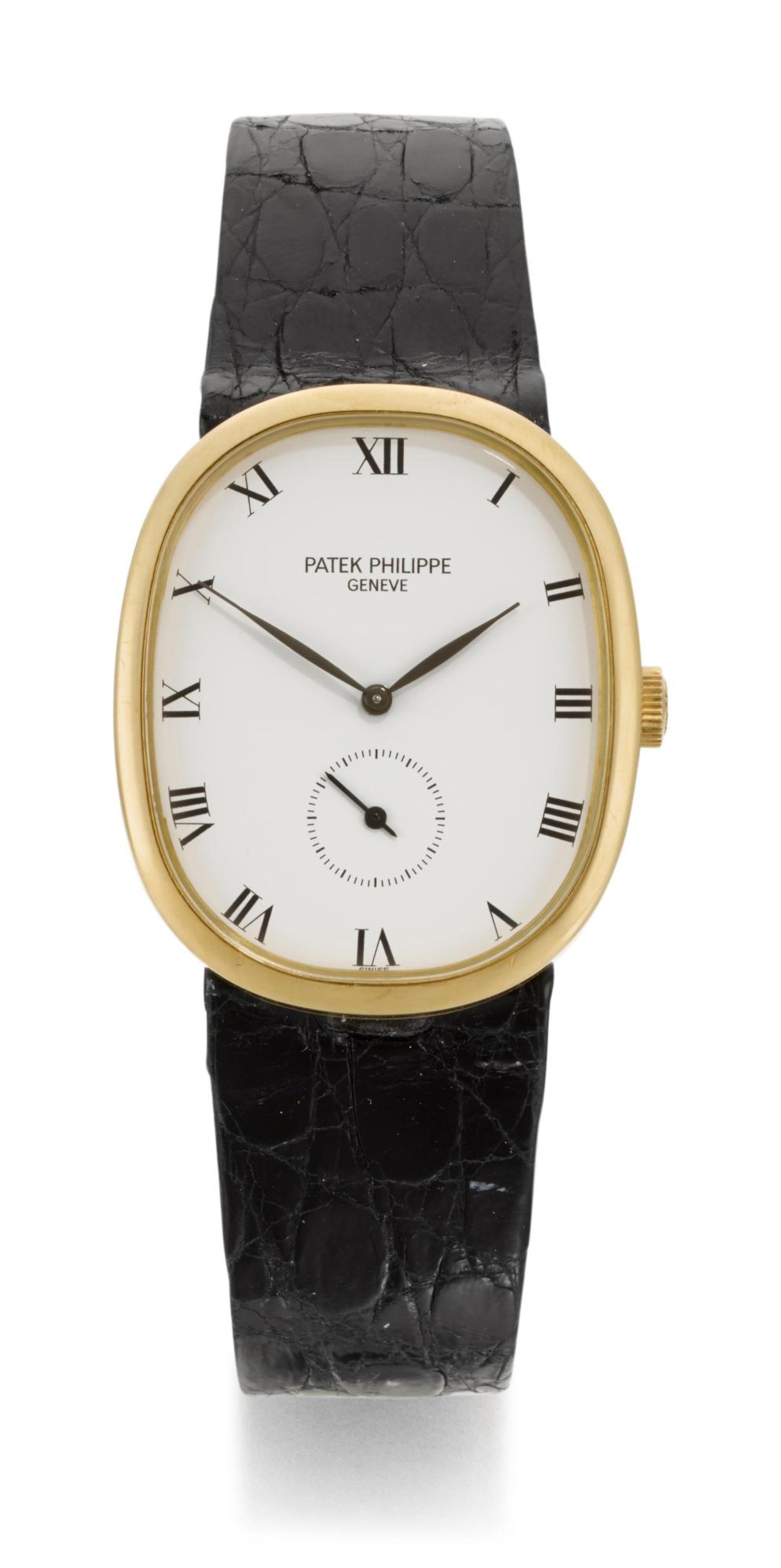View full screen - View 1 of Lot 17. PATEK PHILIPPE | ELLIPSE, REFERENCE 3948  YELLOW GOLD WRISTWATCH  MADE IN 1987.