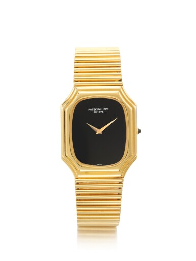 PATEK PHILIPPE   REF 3729/1, A YELLOW GOLD BRACELET WATCH WITH ONYX DIAL MADE IN 1976