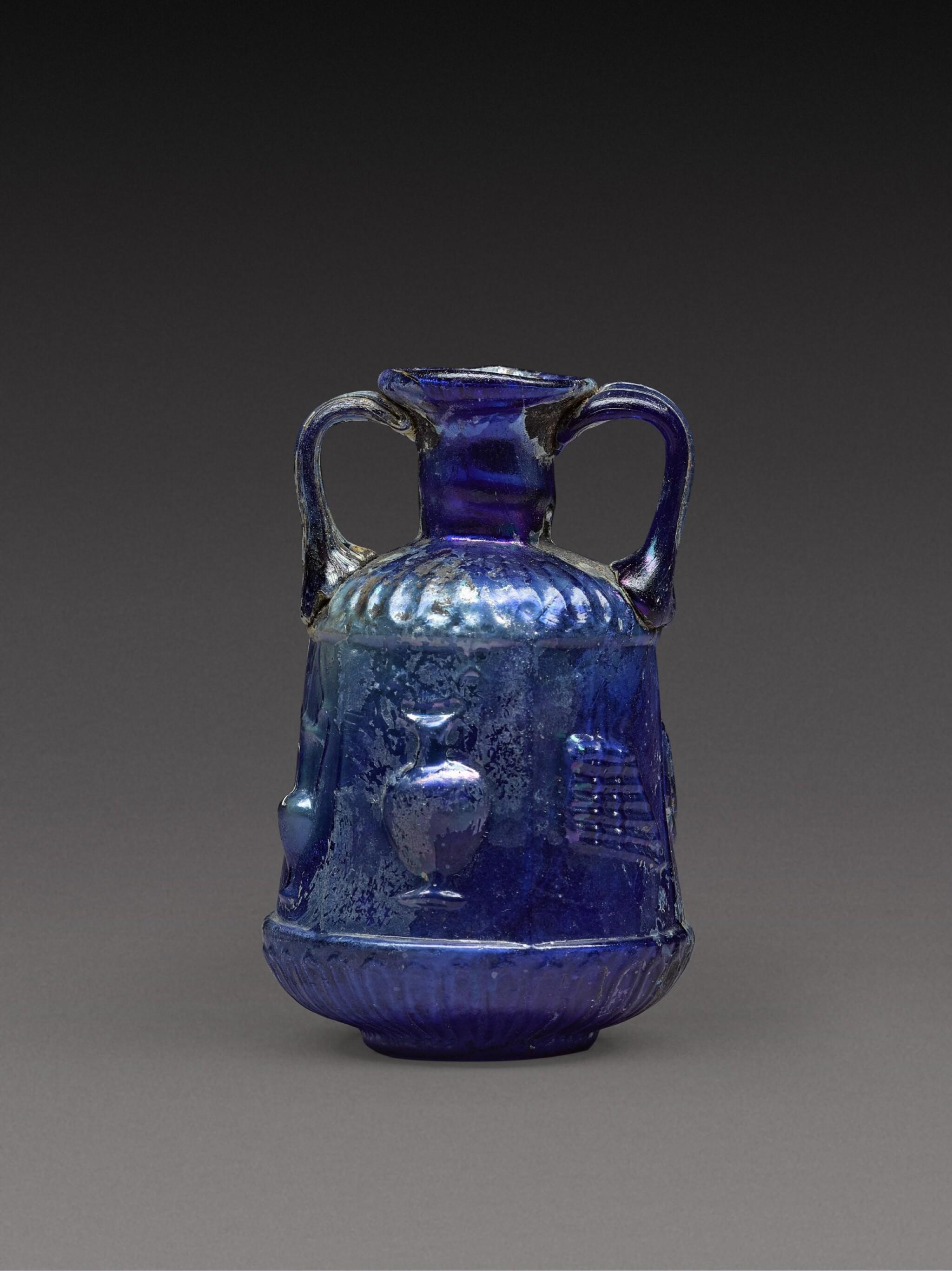 View full screen - View 1 of Lot 3. A Roman Cobalt Blue Mould-Blown Glass Amphoriskos, circa 1st century A.D..