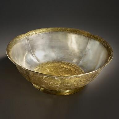 View 1. Thumbnail of Lot 202. A superb and important parcel-gilt silver 'lotus and pomegranate' bowl, Tang dynasty   唐 銀局部鎏金石榴蓮花紋花式大盌.