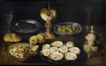 ATTRIBUTED TO OSIAS BEERT AND STUDIO  |  STILL LIFE WITH OYSTERS AND OLIVES ON TIN PLATES, TOGETHER WITH A SILVER SPICE BOX, A NAUTILUS CUP AND A WAN-LI BOWL WITH SUGARED COOKIES