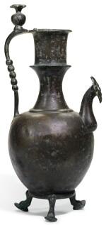 AN UMAYYAD OR EARLY ABBASID BRONZE EWER, PERSIA, 8TH CENTURY AD