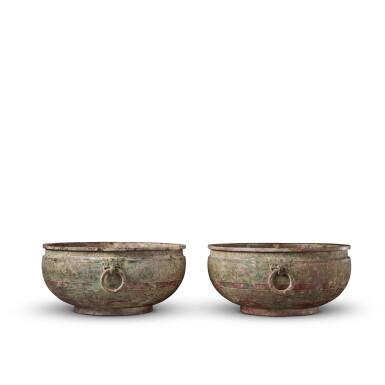 View 2. Thumbnail of Lot 16. A pair of archaic bronze water basins (Jian), Eastern Zhou dynasty, late 6th - early 5th century BC   東周 公元前六世紀末至五世紀初 青銅交龍紋鋪首耳鑒一對.