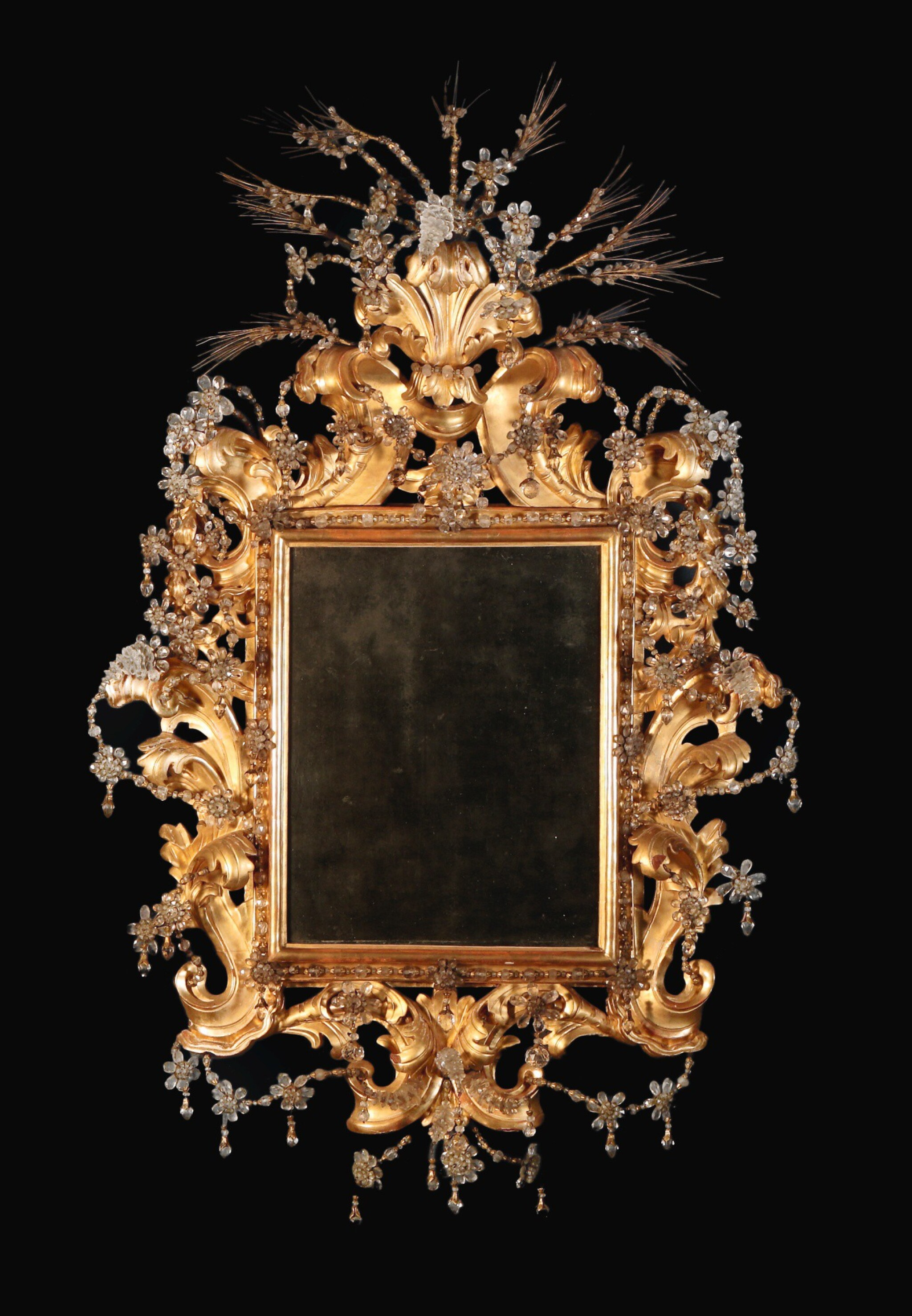 An Italian Baroque rock crystal and carved giltwood mirror, Genoa late 17th/early 18th century
