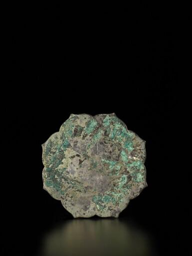 View 2. Thumbnail of Lot 48. A rare gilt-silver-inset bronze mirror, Tang dynasty | 唐 嵌銀鎏金雙鳳狻猊紋銅鏡.