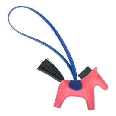 View 2. Thumbnail of Lot 99. Hermès Rose Azalee/Vert Cypress/Bleu Electric Horse Rodeo Bag Charm PM.